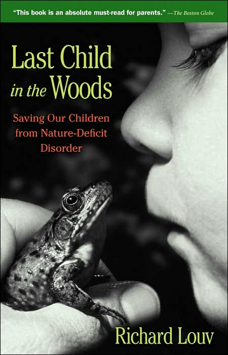 Child kissing a frog for a book cover